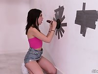 Slutty Jane Wilde masturbates and blows a glory hole dick in public