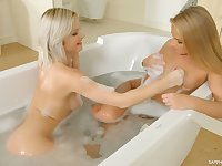 Two libidinous blond babes lick tasty looking pussies in 69 style pose
