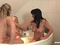 Soapy lesbian hardcore threesome in a bathtub with mature babes