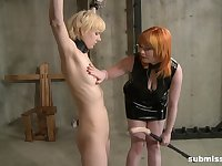 kinky redhead Mistress Irony ties up and tortures a pale blonde teen